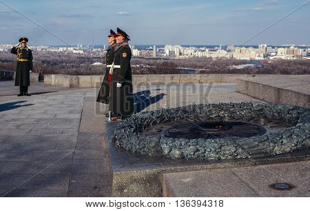Kiev Ukraine - April 8 2015. Military Guard of Honour stands in front of Glory Obelisk and Tomb of the Unknown Soldier