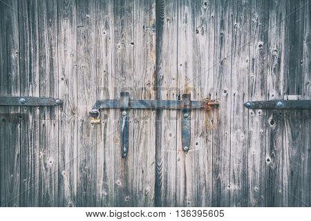 Old antique brown wooden gates in castle