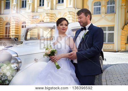 Stylish newly-married couple on a summer wedding day