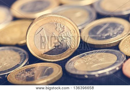 Euro money. Coins are isolated on a dark background. Currency of Europe. Balance of money. Coins values of one and two euro.