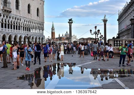 VENICE, ITALY - JUNE 17: Tourists visit St Mark Square in Venice at sunset after high tide  JUNE 17, 2016 in Venice, Italy