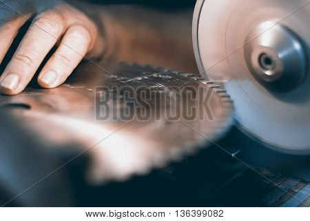 Sharpening Circular Saw, worker sharpens a circular saw blade. Selective focus and shallow Depth of field