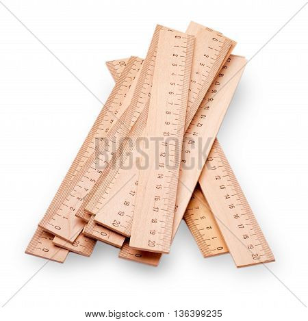 Yellow wooden centimeter ruler cut out on white background