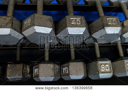 Dumb bells on a rack in a gym