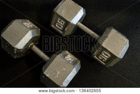 90 pound dumbbells on a gym floor