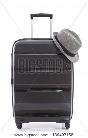 black travel bag and straw hat on white background isolated