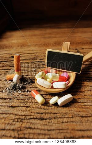 concept ideas of healthy stop smokingcigarette with medicine on woodenbad health