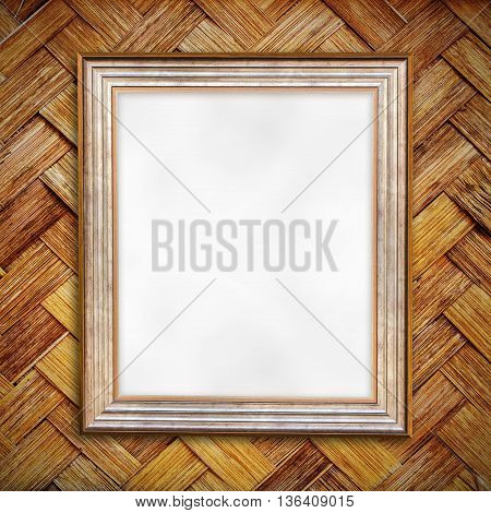Blank of wooden photo frame on old bamboo wall background.