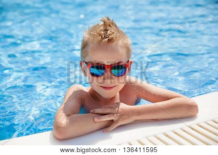 portrait of young caucasian boy in swimming pool