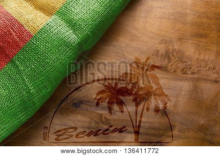 Flag of Benin and imprint on wooden Made in Benin