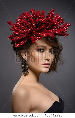 Beauty Portrait Of Handsome European Girl With Red Berries Of Viburnum On Head As A Hairstyle.
