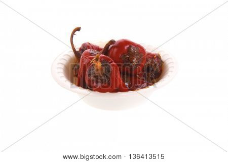 red hot small chili pepper in side bowl isolated ove white background