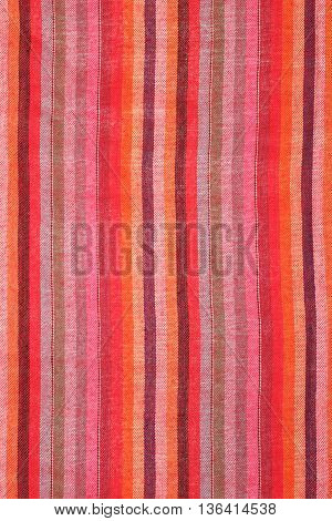 Colorful striped shawl scarf as background texture multicolored fabric as backdrop