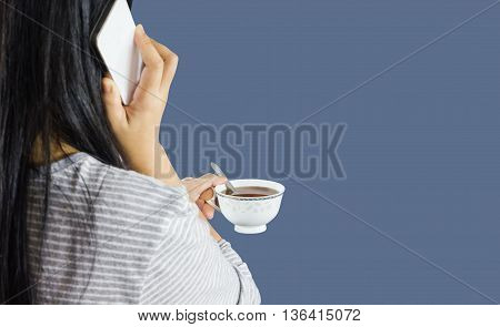 Women Hold Cup Of Coffee And Talking On Mobile Or Smartphone