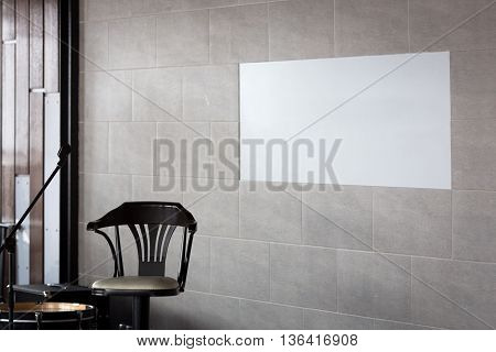 A chair a microphone stand, wall preparation for the concert, tile, copy space
