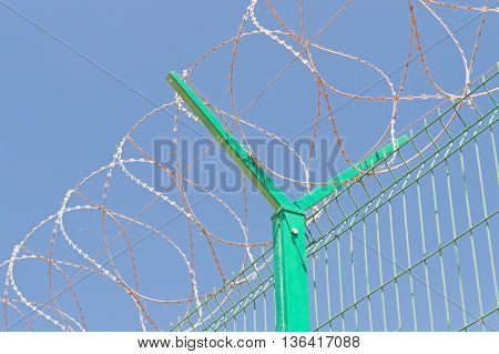 fence with barbed wire and blue sky