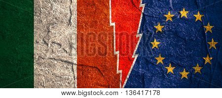 Image relative to politic relationships between European Union and Italy. National flags divided by high voltage sign. Concrete textured