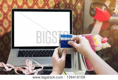 Hands Pull Credit Or Debit Card Out Of Wallet And Laptop Or Notebook