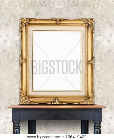 Blank Vintage Golden Photo Frame Lean At Light Color Concrete Wall On Wood Table