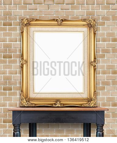 Blank Vintage Golden Photo Frame Lean At Pale Orange Brick Wall On Wood Table