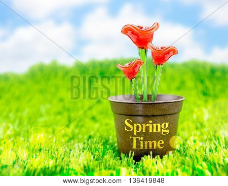 Red Flower Made Of Glass In Brown Flowerpot On Green Grass With Blue Sky And Bokeh Light,spring Seas
