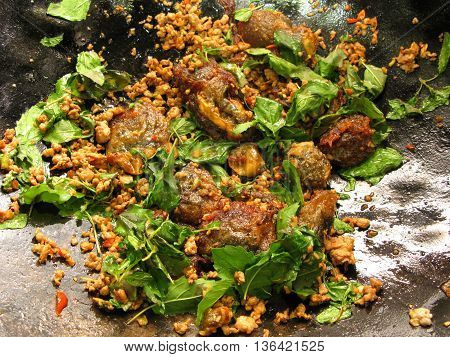 cooking for stir-fried pork with basil and preserved egg chili food thai style