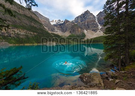 chilly jump into a glacier fed lake during the summer in the rockies.