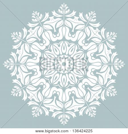 Oriental round pattern with white arabesques and floral elements. Traditional classic ornament