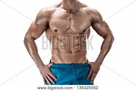 Strong Athletic Man showing muscular body and sixpack abs over white background. Close-up