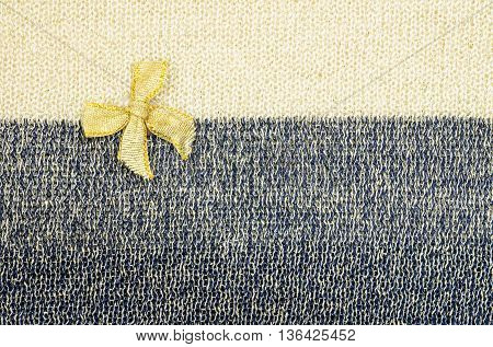 Gold ribbon on two tone fabric texture background