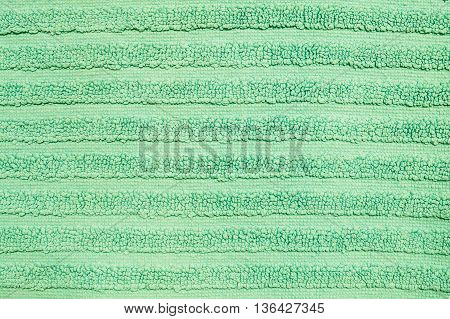 Closeup surface fabric pattern at the old green mat texture background