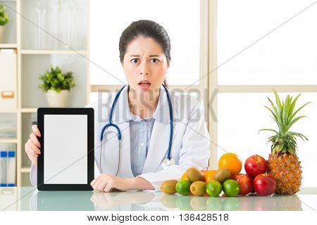 Doctor Nutritionist With Fruits And Holding Digital Tablet Fell Fear