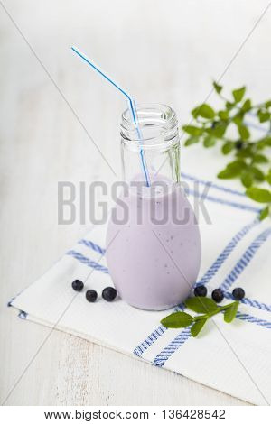 Bilberry smoothie on a wooden table ,