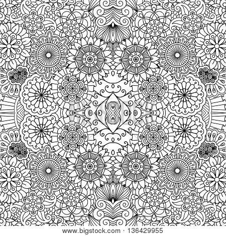 Full frame beautiful symmetrical seamless background filled with circular  flower like shapes in black and white