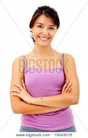 Beautiful fitness woman smiling isolated over a white background