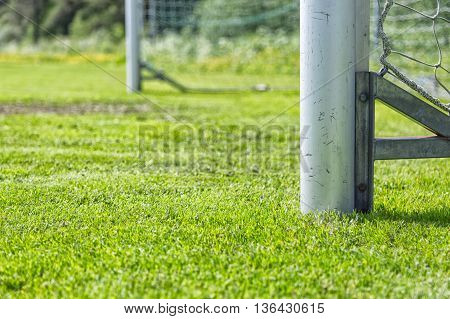 A Soccer Goal Post with green grass.
