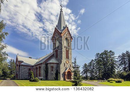 Old stone church in Finnish Karelia in summer.