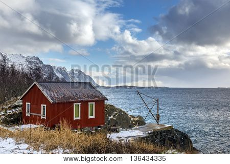 Red wooden house called rorbu at the Lofoten archipelago Norway