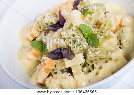 Pasta bowl with parmesan cheese and basil