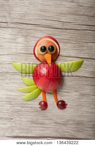 Bird made of fresh fruits on board