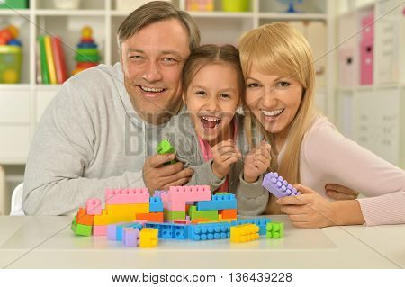 Portrait of happy family playing at home