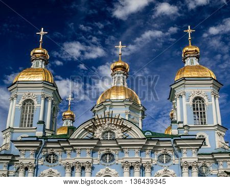 Golden dome of St. Nicholas Cathedral in Saint Petersburg on a clear sunny day