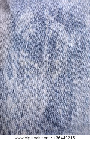 torn old blue jeans background texture close up
