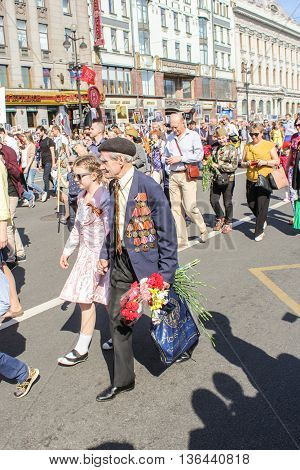 St. Petersburg, Russia - 9 May, A war veteran with flowers and medals, 9 May, 2016. Holiday-action