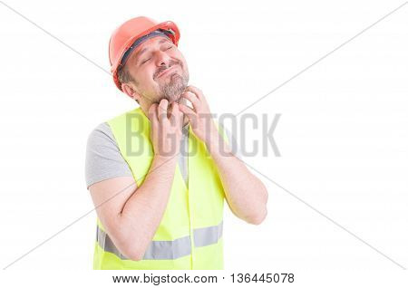 Attractive Young Constructor Having Itchy On Beard