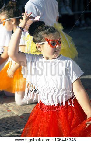 Montenegro, Herceg Novi - 04/06/2016: The girl in the masquerade mask dances. 10 International Children's Carnival in Herceg Novi