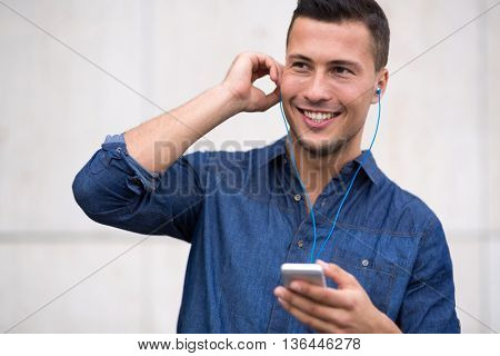 Man listening to music on mobile phone