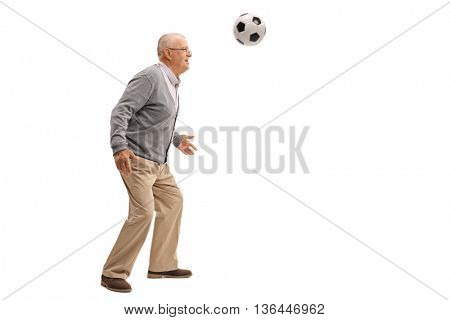 Cheerful senior playing with a football isolated on white background