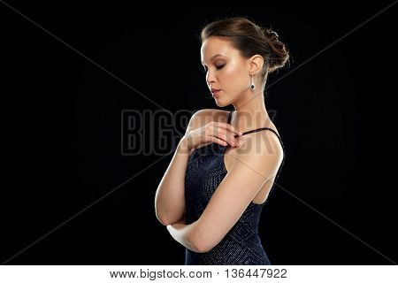 beauty, jewelry, wedding accessories, people and luxury concept - beautiful asian woman with diamond earring over black background