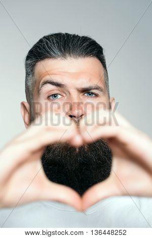 Bearded Man With Hands In Heart Shape